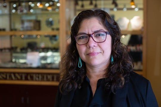 Holandesa Lopez works in a jewelry store in Sacramento. Andrew Nixon / Capital Public Radio
