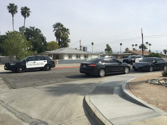 Palm Springs police vehicles park on Sunny Dunes Road at Desert Way on March 26. Police investigated a shooting at a home on Desert Way, but no one was injured.