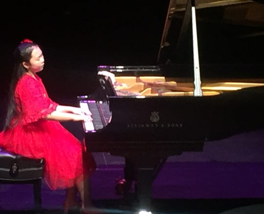 Rachel Wei, 11 of Hong Kong, performs in the Junior Solo Competition Sunday during the Virginia Waring International Piano Competition