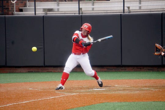 Hayley Norton, a Spring Grove graduate, prepares to make contact at the plate playing softball for St. Francis University.