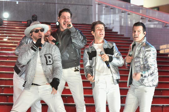 Donnie Wahlberg, Danny Wood, Jonathan Knight, Joey McIntyre and Jordan Knight of New Kids on the Block perform at Dick Clark's New Year's Rockin' Eve With Ryan Seacrest 2019 in New York City.
