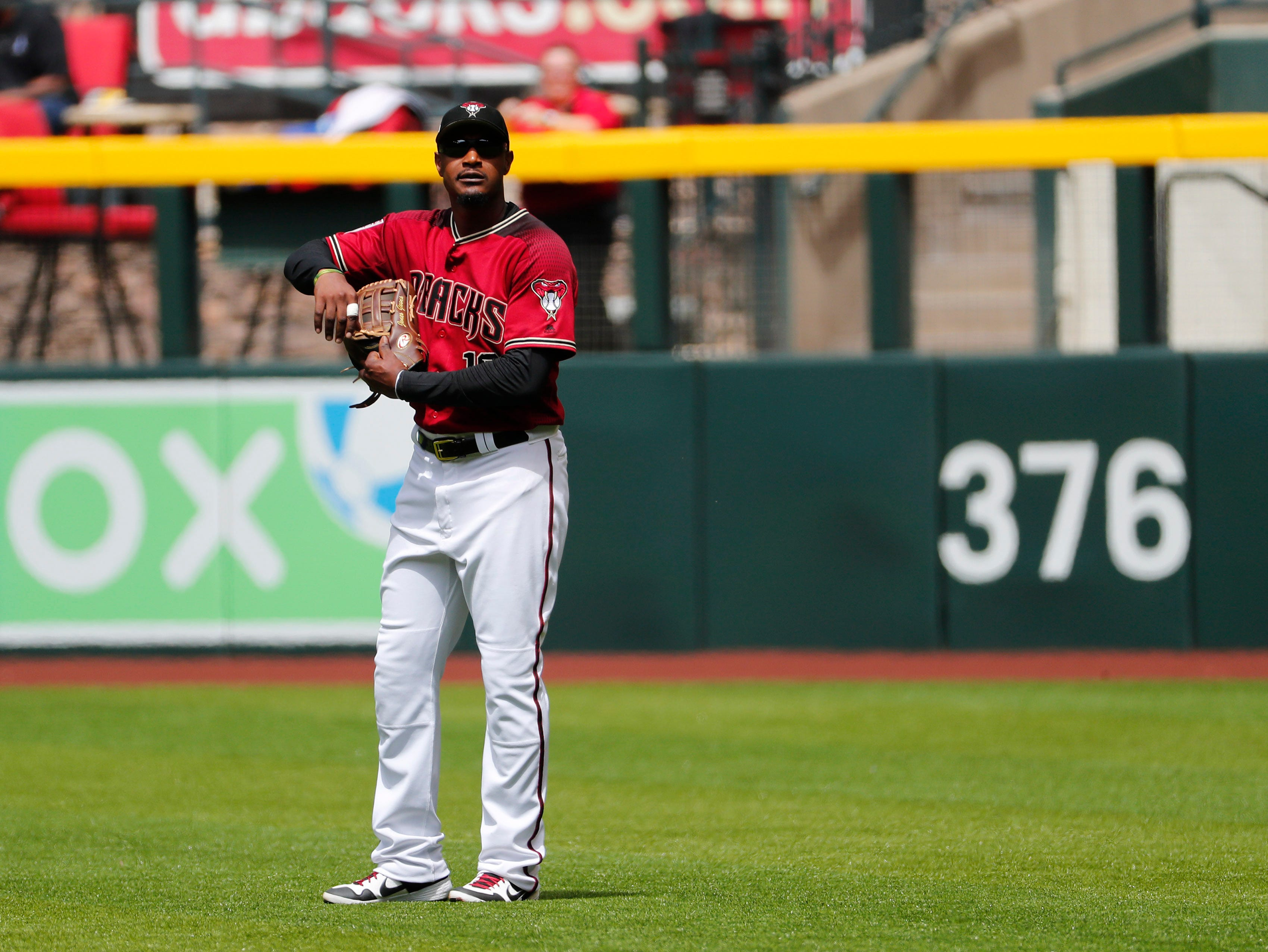 Arizona Diamondbacks right fielder Adam Jones (10) waits for a video review during spring training action against the Chicago White Sox at Chase Field March 26, 2019.