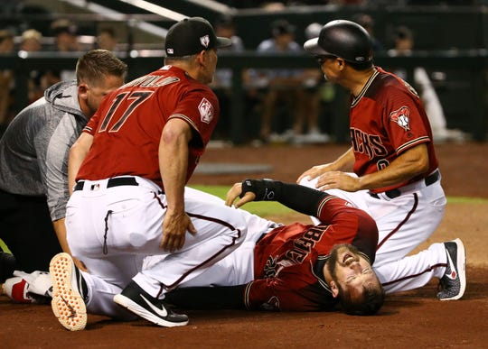 Arizona Diamondbacks Steven Souza Jr. falls to the ground following a serious injury to his leg after scoring against the Chicago White Sox in the fourth inning during a spring training game on Mar. 25, 2019 at Chase Field in Phoenix, Ariz. Steven Souza Jr. was carried from the field.