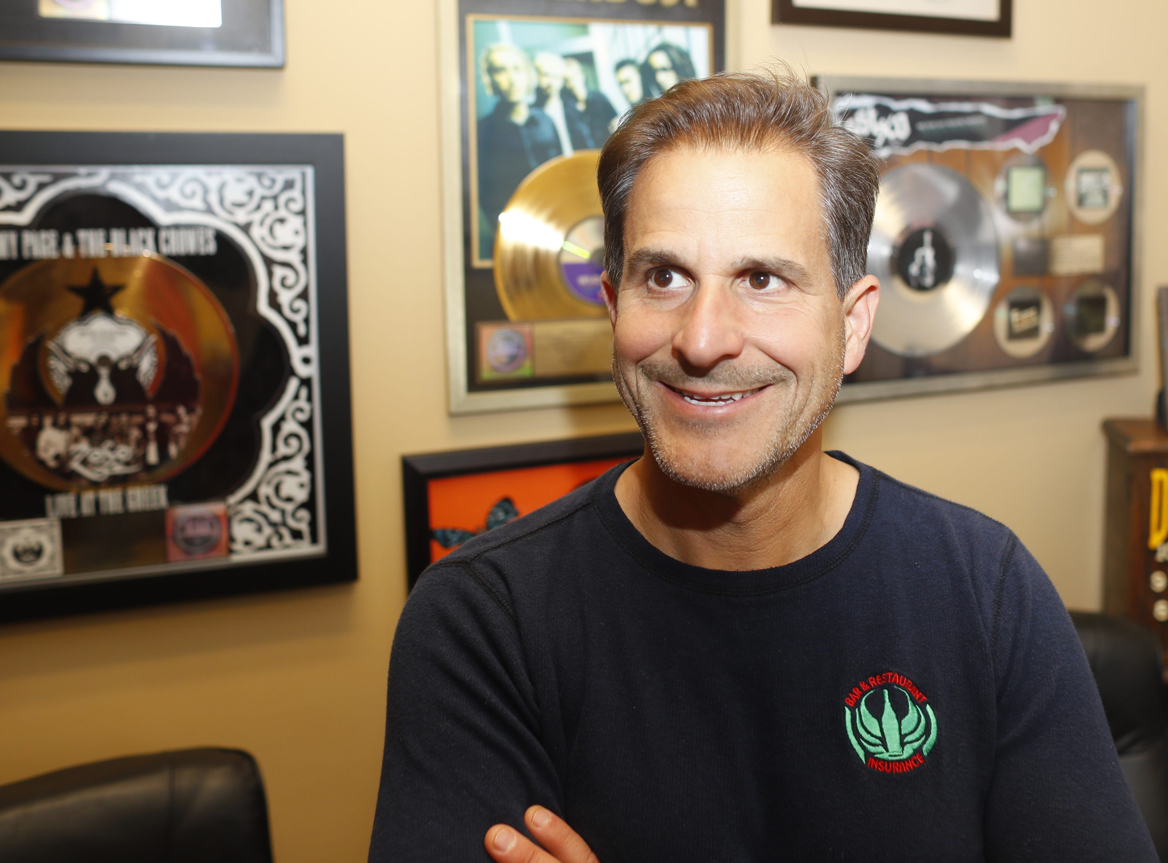 """David DeLorenzo's office walls at the Bar and Restaurant Insurance, The Ambassador Group hold gold and platinum record reminders of his past career. """"When the industry changed, it wasn't the glamorous or fun job it had been,"""" he says."""