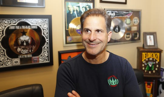 "David DeLorenzo's office walls at the Bar and Restaurant Insurance, The Ambassador Group hold gold and platinum record reminders of his past career. ""When the industry changed, it wasn't the glamorous or fun job it had been,"" he says."