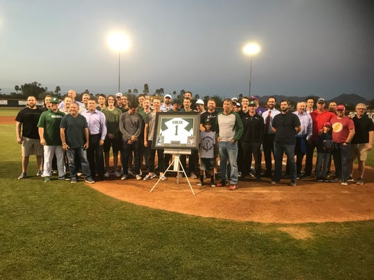 Eric Kibler poses with former Horizon players during his jersey retirement ceremony on Monday at Horizon High.