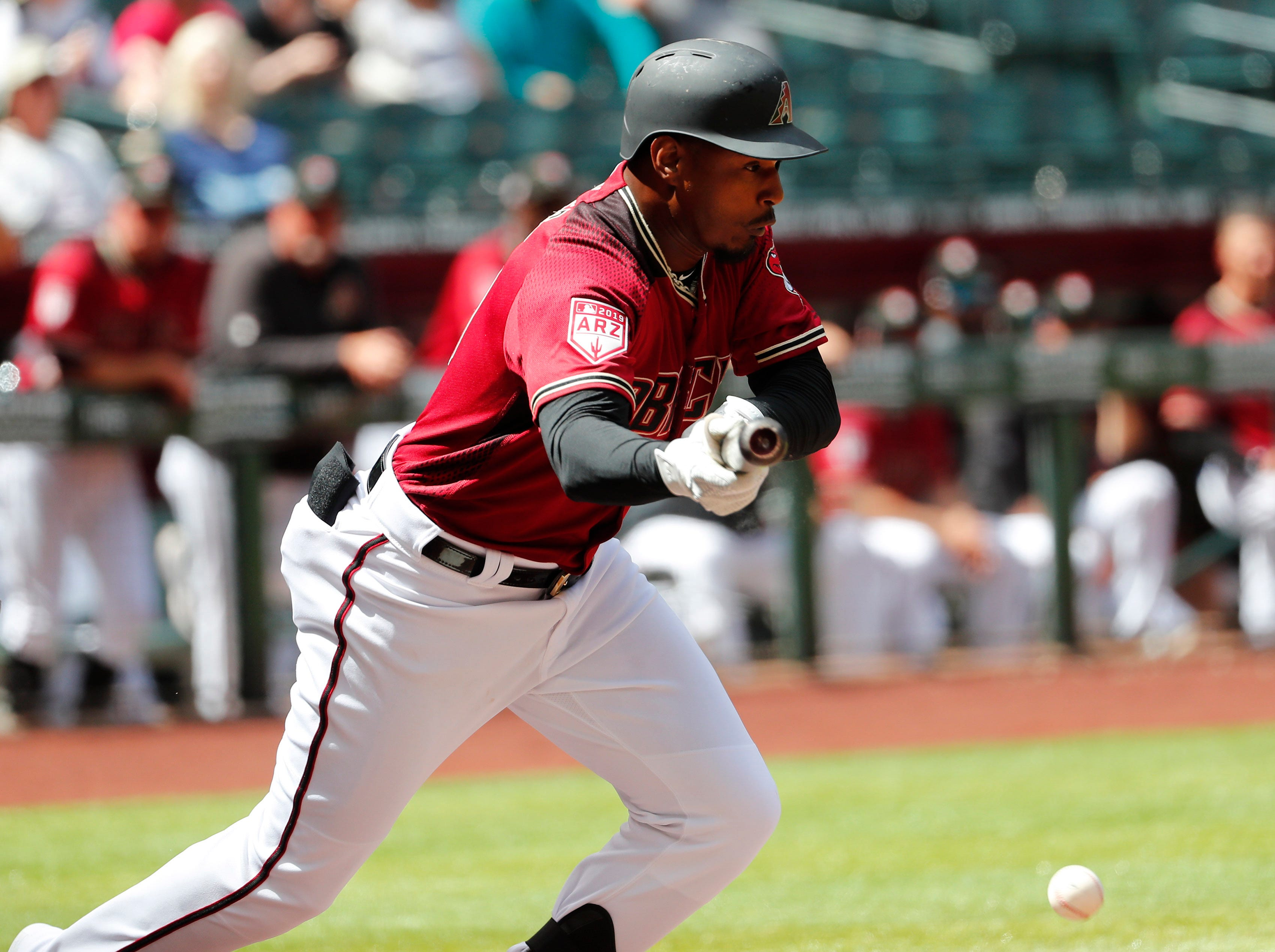 Arizona Diamondbacks right fielder Adam Jones (10) attempts to bunt against the Chicago White Sox during spring training action at Chase Field March 26, 2019.