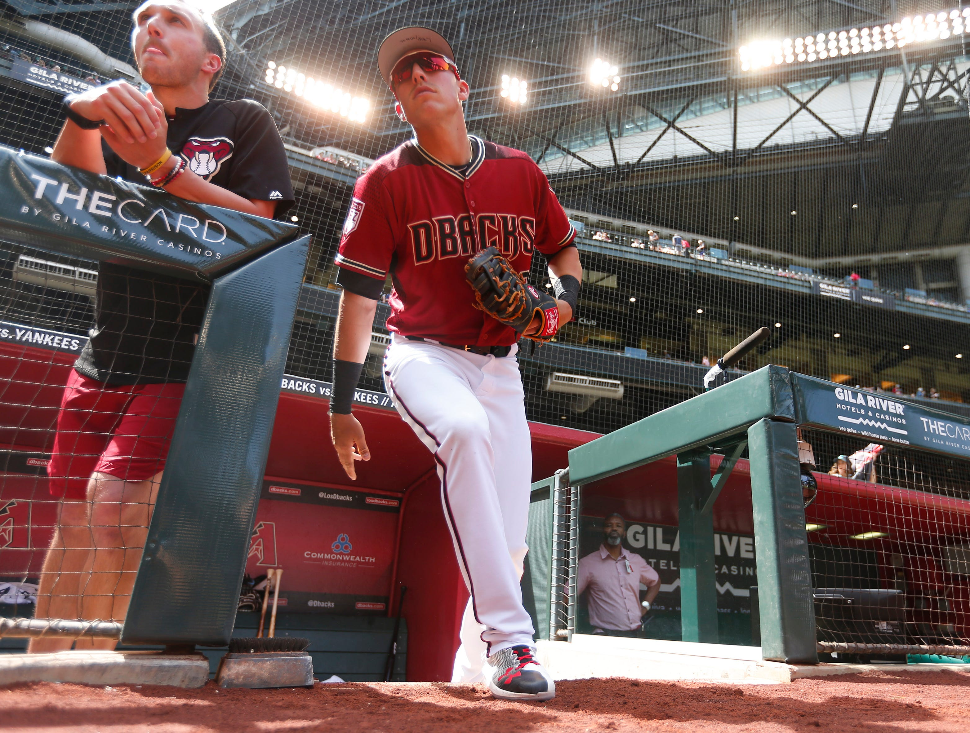 Arizona Diamondbacks first baseman Jake Lamb (22) takes the field for spring training action against the Chicago White Sox at Chase Field March 26, 2019.