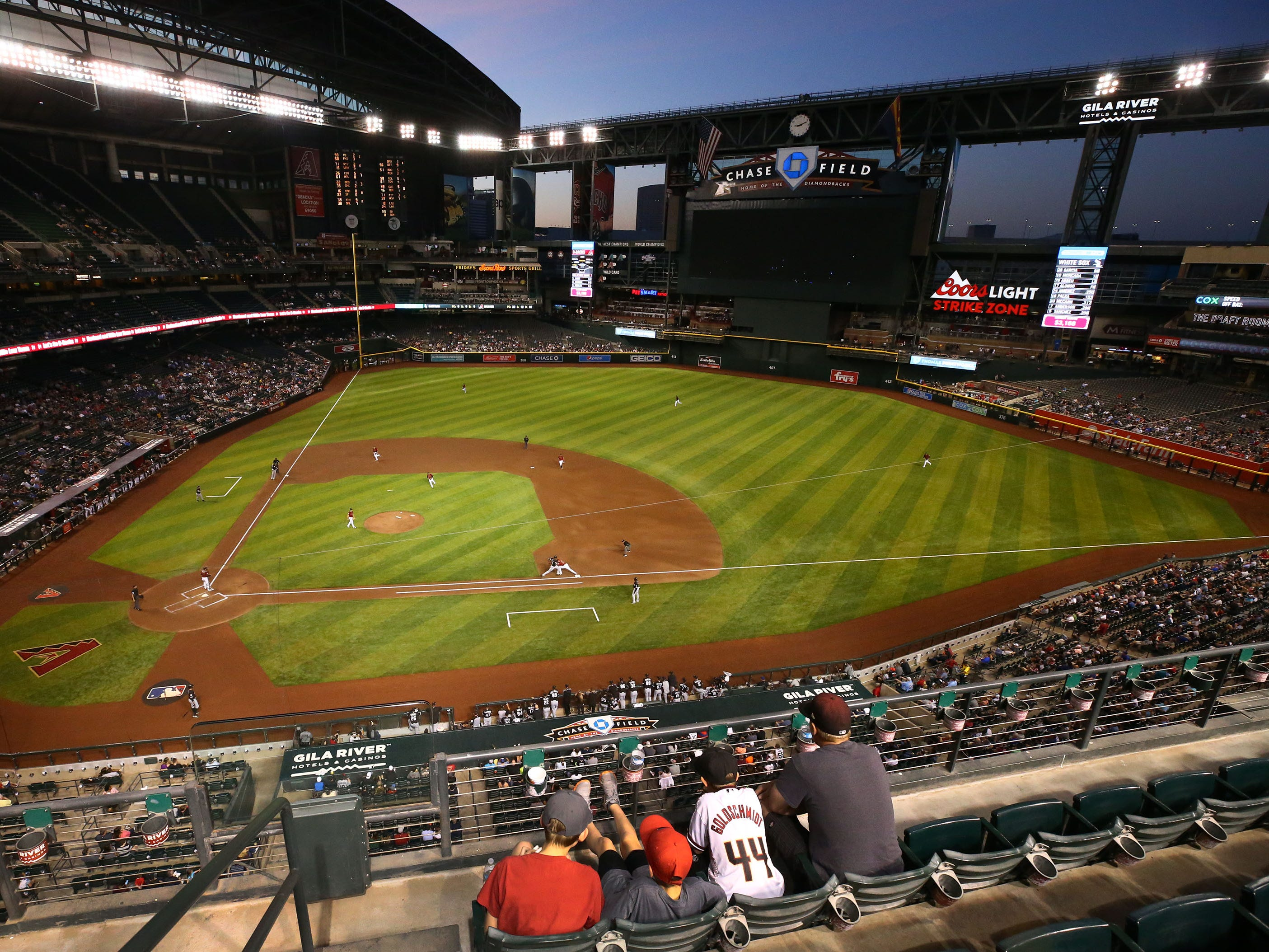 Arizona Diamondbacks fans watch the action against the Chicago White Sox in the second inning during a spring training game on Mar. 25, 2019 at Chase Field in Phoenix, Ariz.