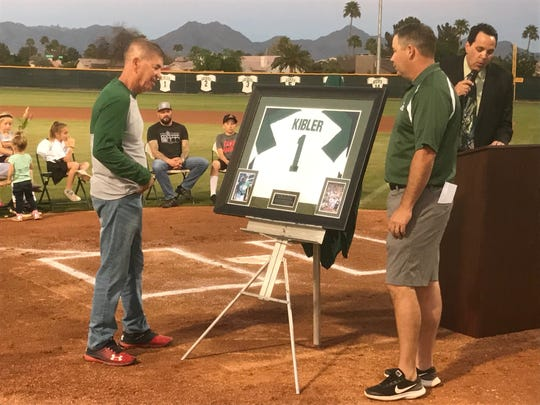 Eric Kibler with former player Tim Huff during Monday's jersey retirement ceremony.
