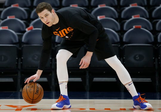 Phoenix Suns guard Jimmer Fredette warms up before the start of their NBA basketball game against the Utah Jazz Monday, March 25, 2019, in Salt Lake City. (AP Photo/Rick Bowmer)