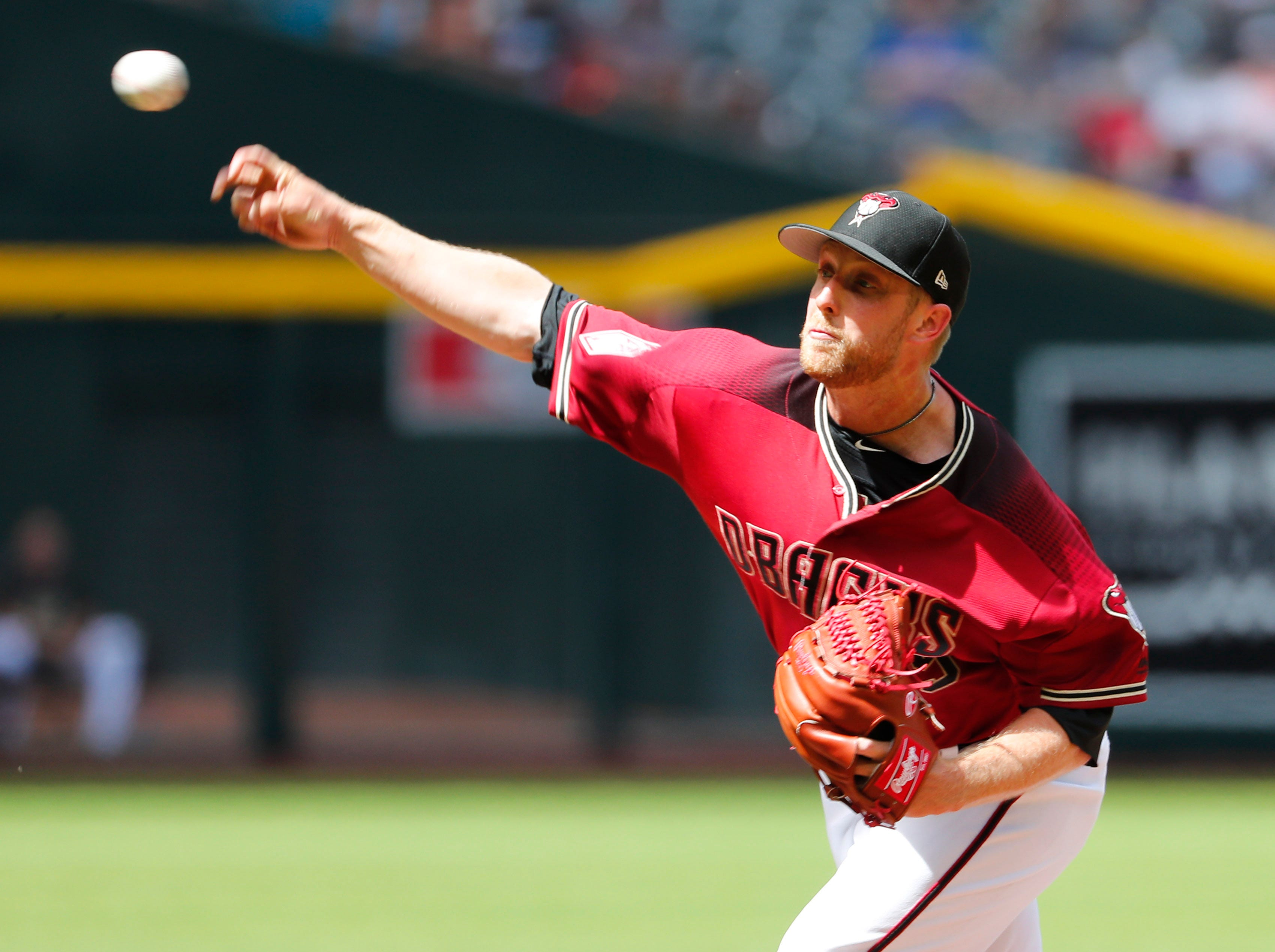 Arizona Diamondbacks starting pitcher Merrill Kelly (29) throws against the Chicago White Sox during spring training action at Chase Field March 26, 2019.
