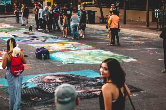 Inside Chalk-A-Lot Street, professional artists and guests of all ages create chalk murals.