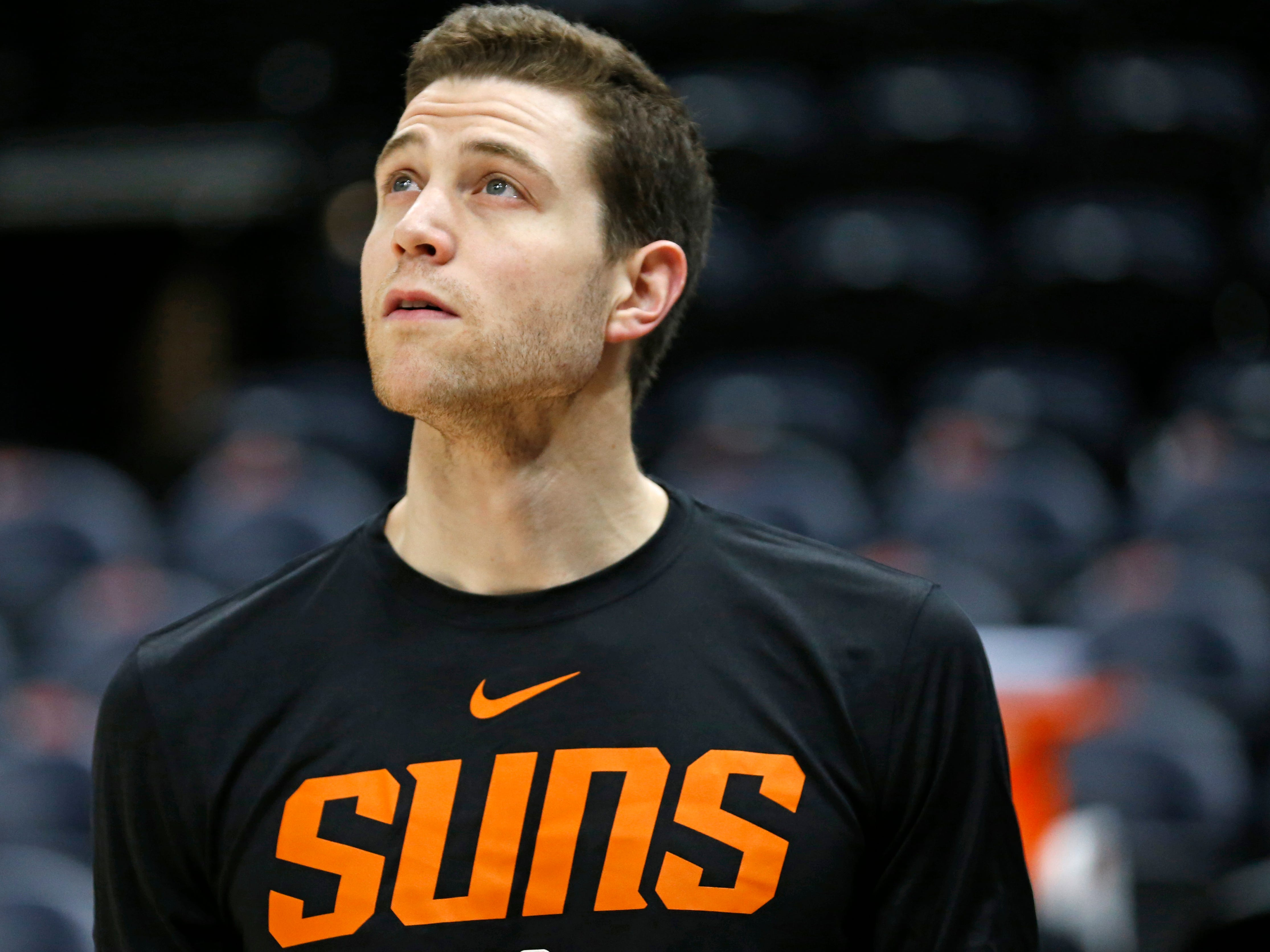 Phoenix Suns guard Jimmer Fredette looks on while warming-up before the start of their NBA basketball game against the Utah Jazz Monday, March 25, 2019, in Salt Lake City.