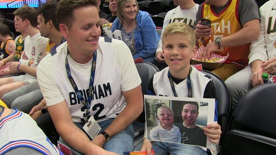 Brad Roberts, 33, and his son Benson, 9, drove from Provo to see Jimmer Fredette play against the Utah Jazz. Fredette starred at BYU, which is in Provo. The picture is Benson with Fredette. His dad said Benson was two at the time of the photo.
