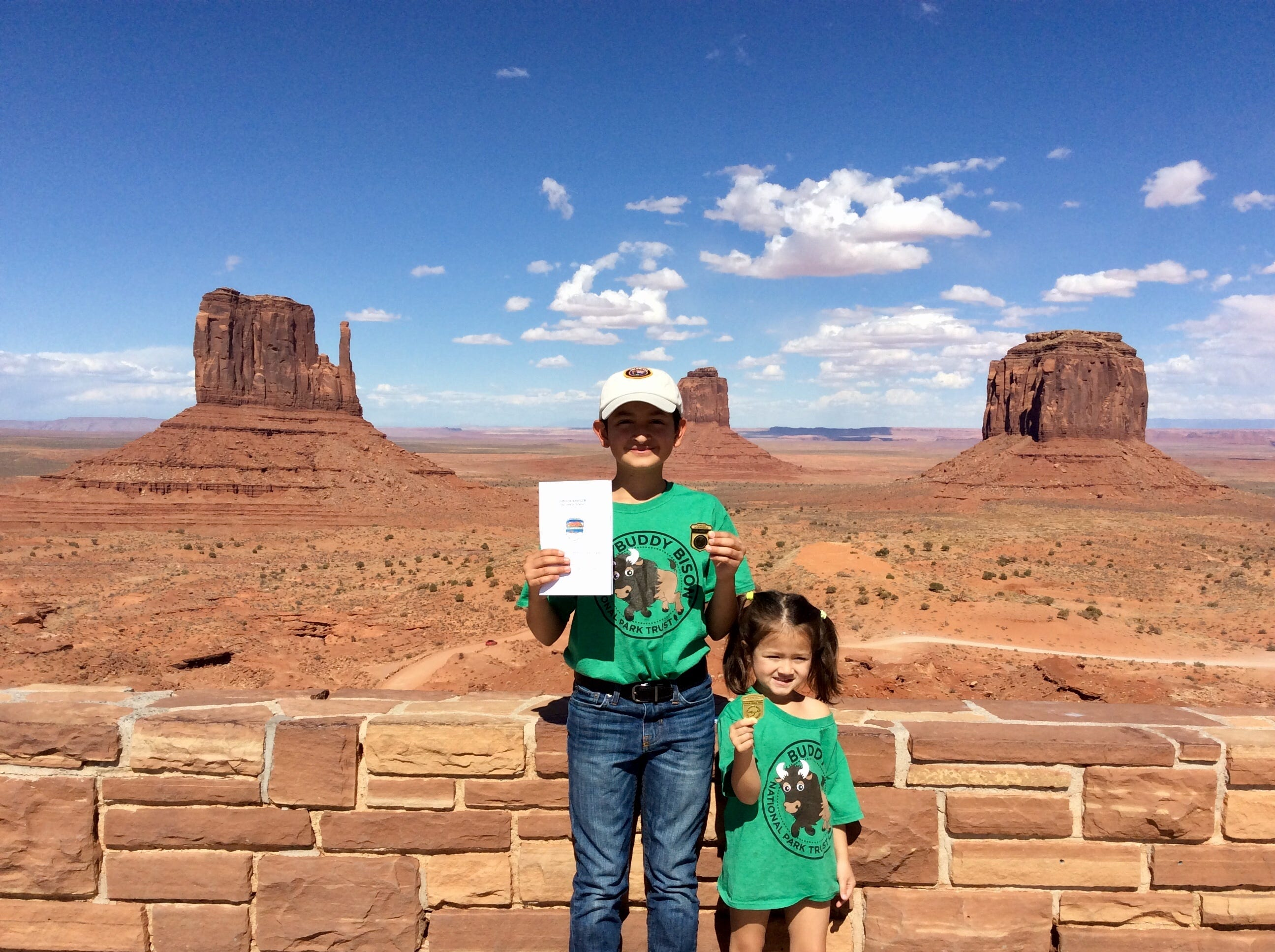 Bryan Wilson, 12, with sister Penelope, 4, at Monument Valley Tribal Park showing off their park ranger badges.