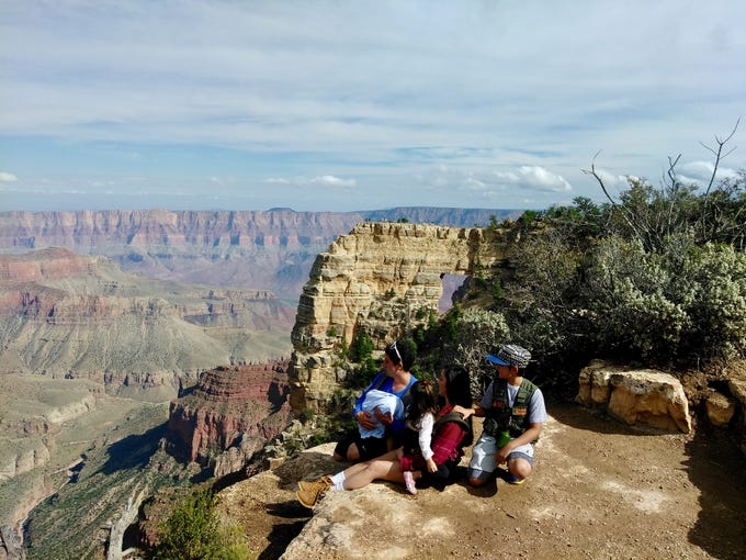 Bryan Wilson, 12, with his family at the north rim of Grand Canyon National Park, his favorite national park in Arizona.