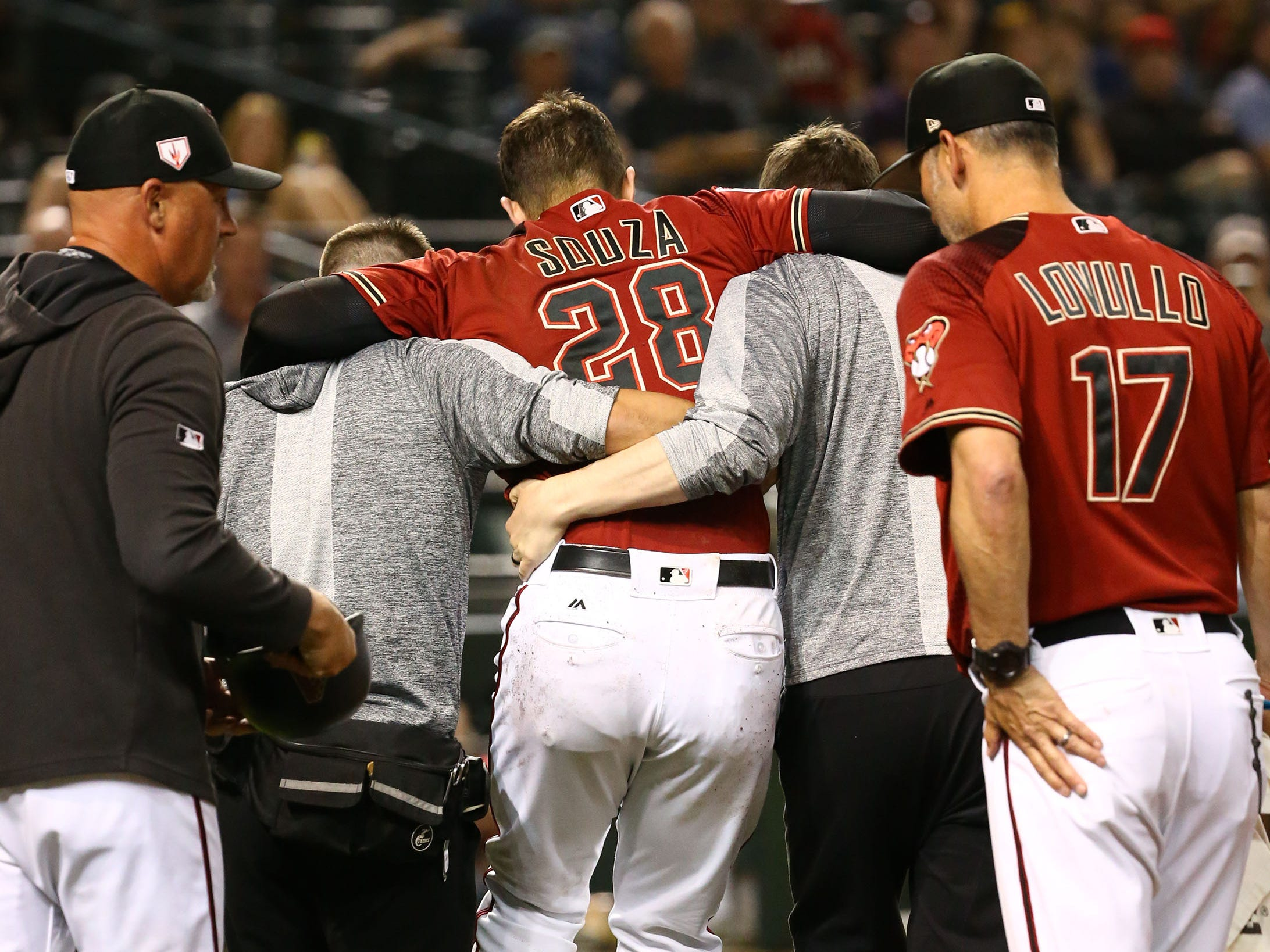 Arizona Diamondbacks Steven Souza Jr. is carried from the field after suffering an injury to his leg against the Chicago White Sox in the fourth inning during a spring training game on Mar. 25, 2019 at Chase Field in Phoenix, Ariz.