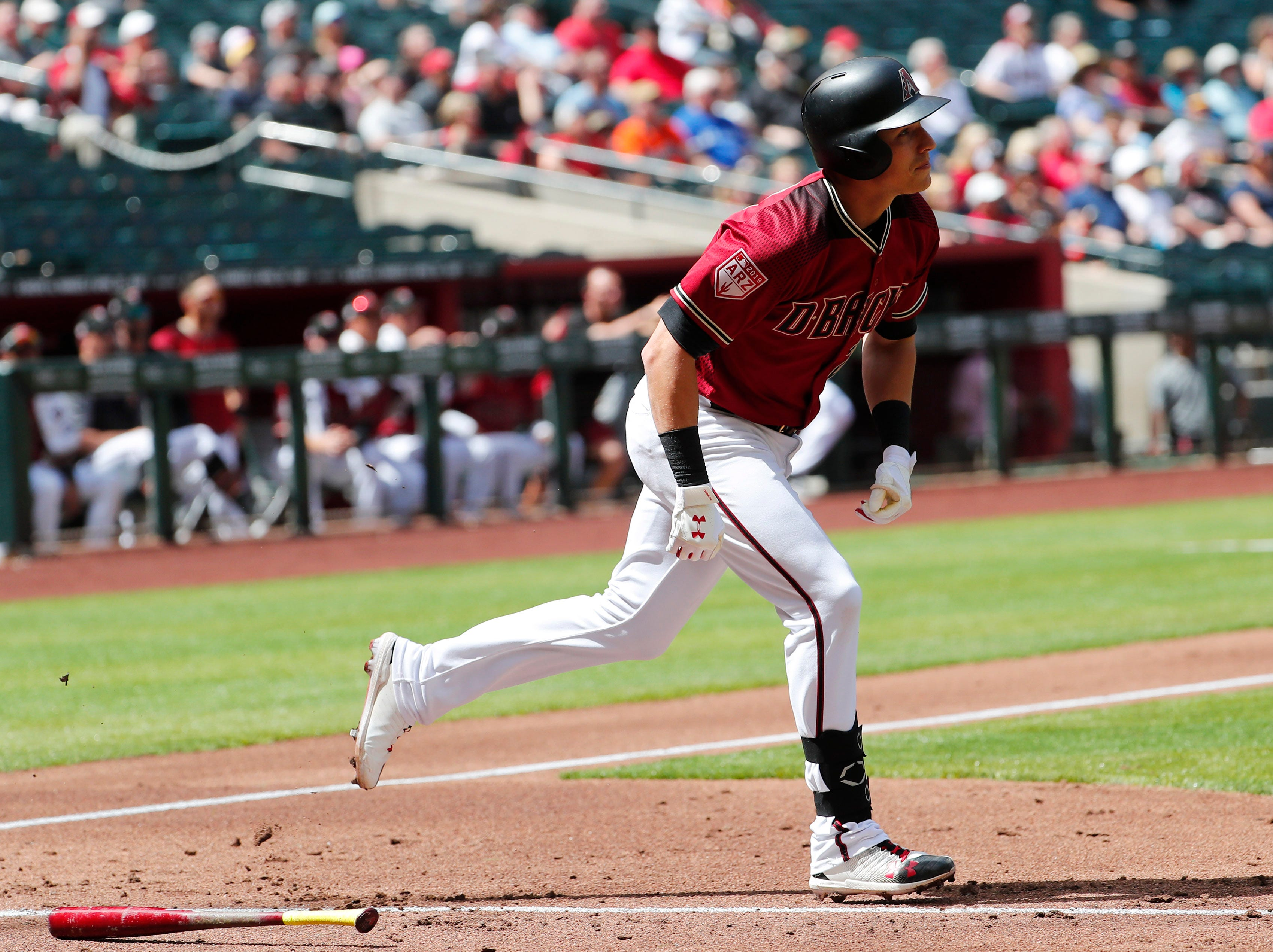 Arizona Diamondbacks first baseman Jake Lamb (22) hits a home run against the Chicago White Sox during spring training action at Chase Field March 26, 2019.