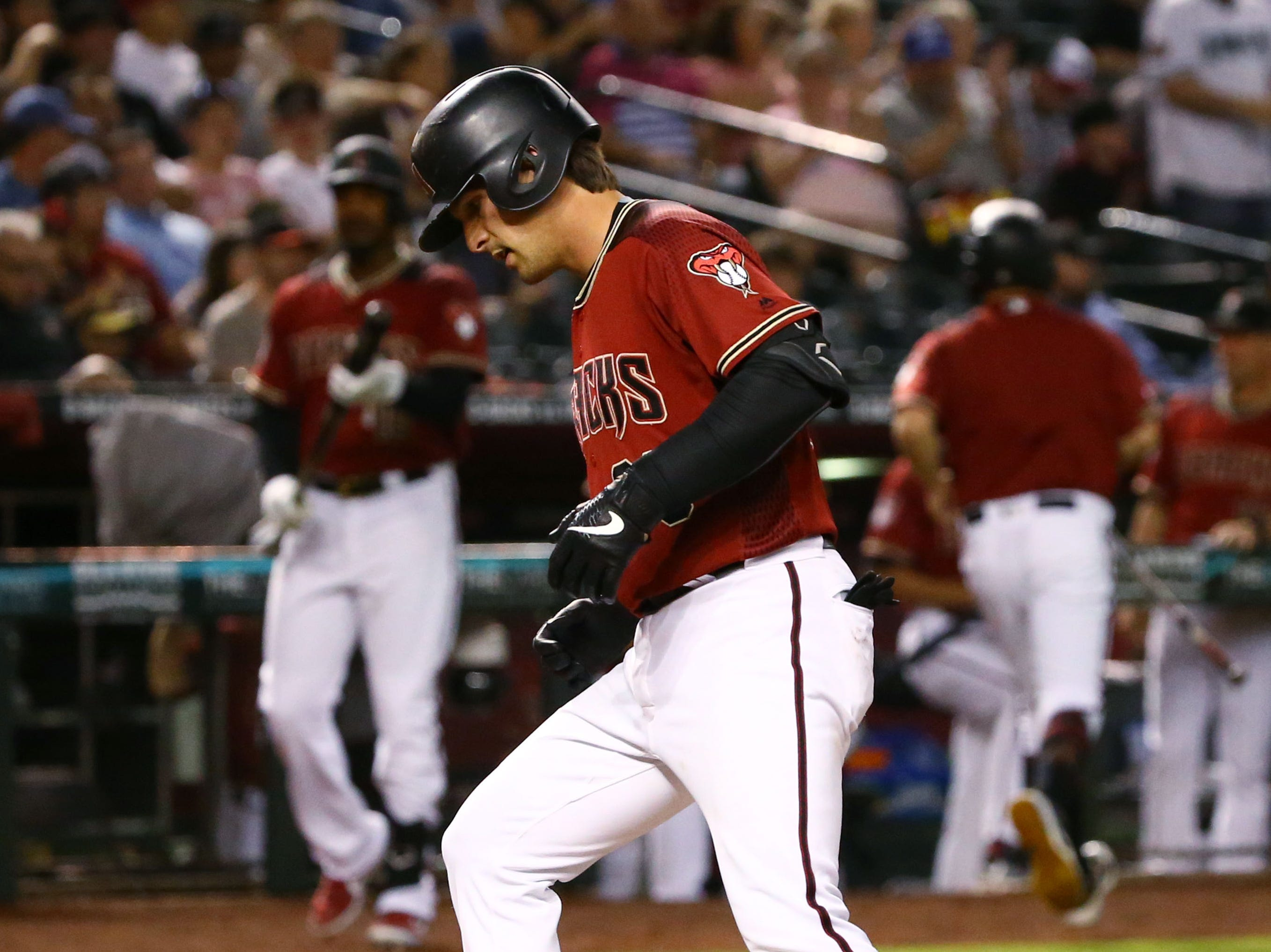 Arizona Diamondbacks John Ryan Murphy (36) steps on home plate after hitting as solo home run against the Chicago White Sox in the third inning during a spring training game on Mar. 25, 2019 at Chase Field in Phoenix, Ariz.