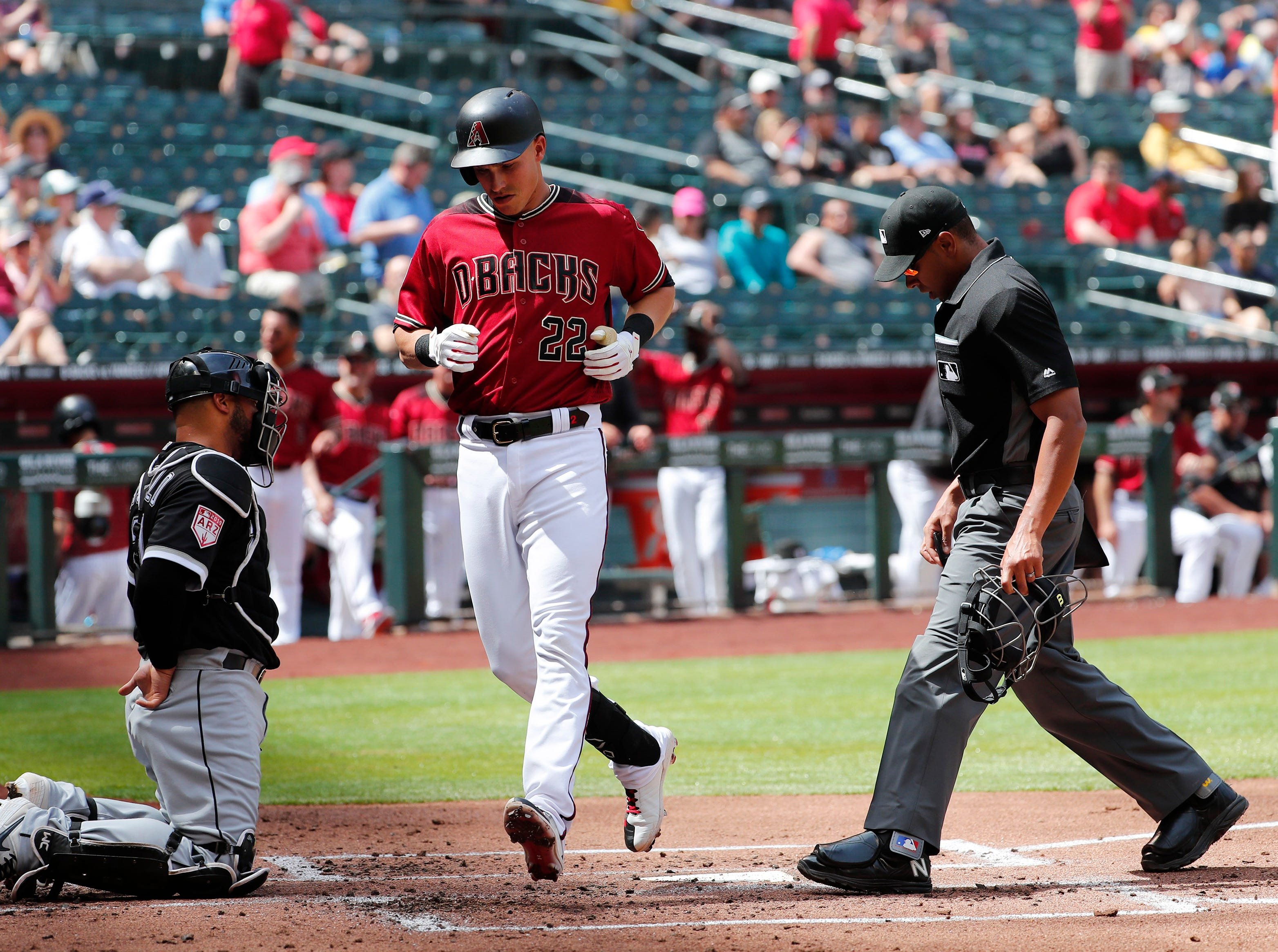 Arizona Diamondbacks first baseman Jake Lamb (22) crosses home plate after hitting a solo home run against the Chicago White Sox during spring training action at Chase Field March 26, 2019.