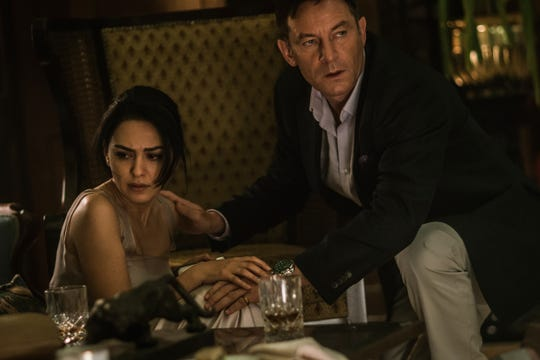 "Nazanin Boniadi and Jason Isaacs star in ""Hotel Mumbai."""