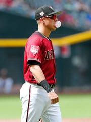 Arizona Diamondbacks first baseman Jake Lamb (22) blows a bubble during spring training action against the Chicago White Sox at Chase Field March 26, 2019.