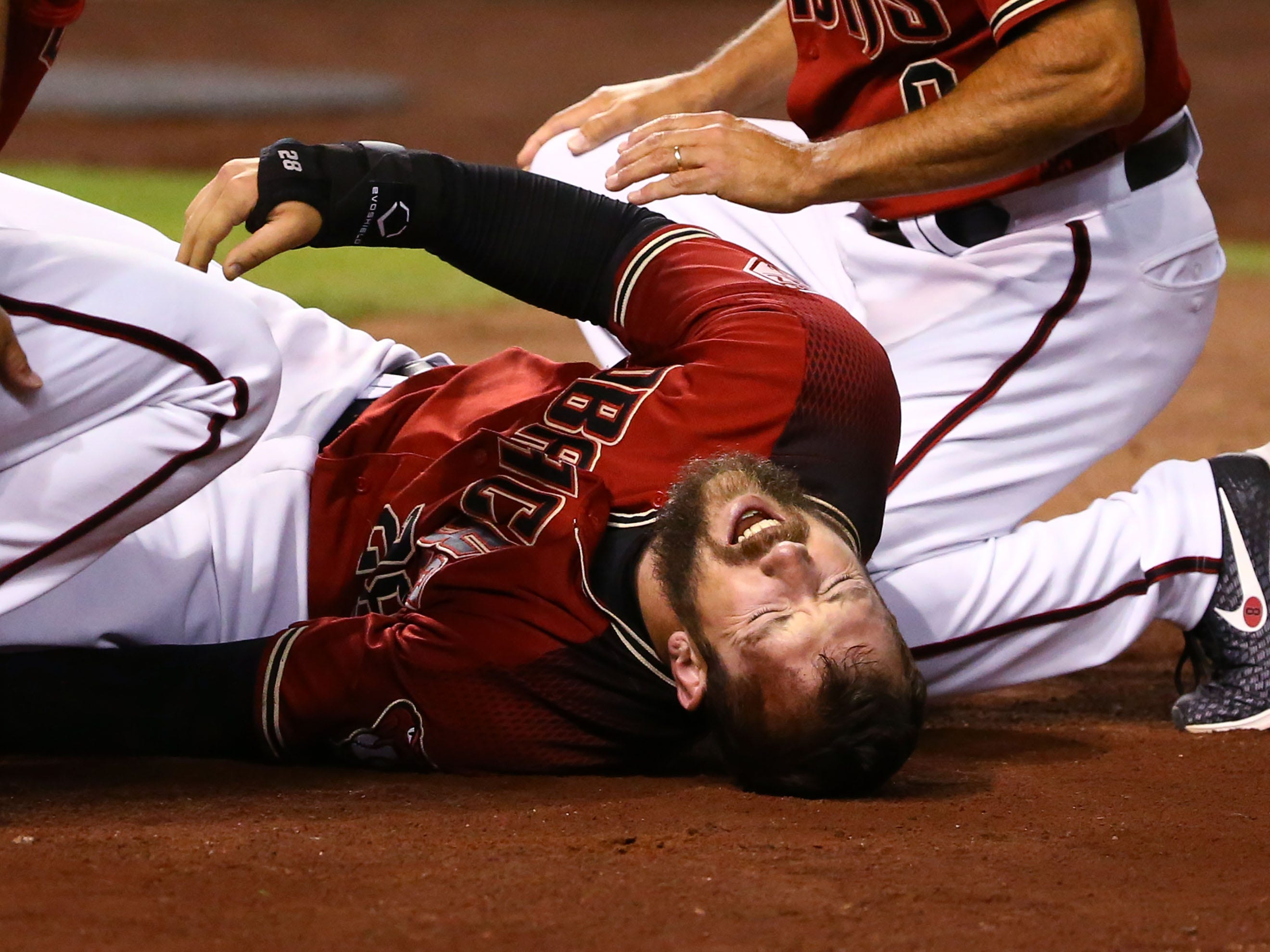 Arizona Diamondbacks Steven Souza Jr. reacts after suffering an injury to his leg after scoring against the Chicago White Sox in the fourth inning during a spring training game on Mar. 25, 2019 at Chase Field in Phoenix, Ariz. Steven Souza Jr. was carried from the field.