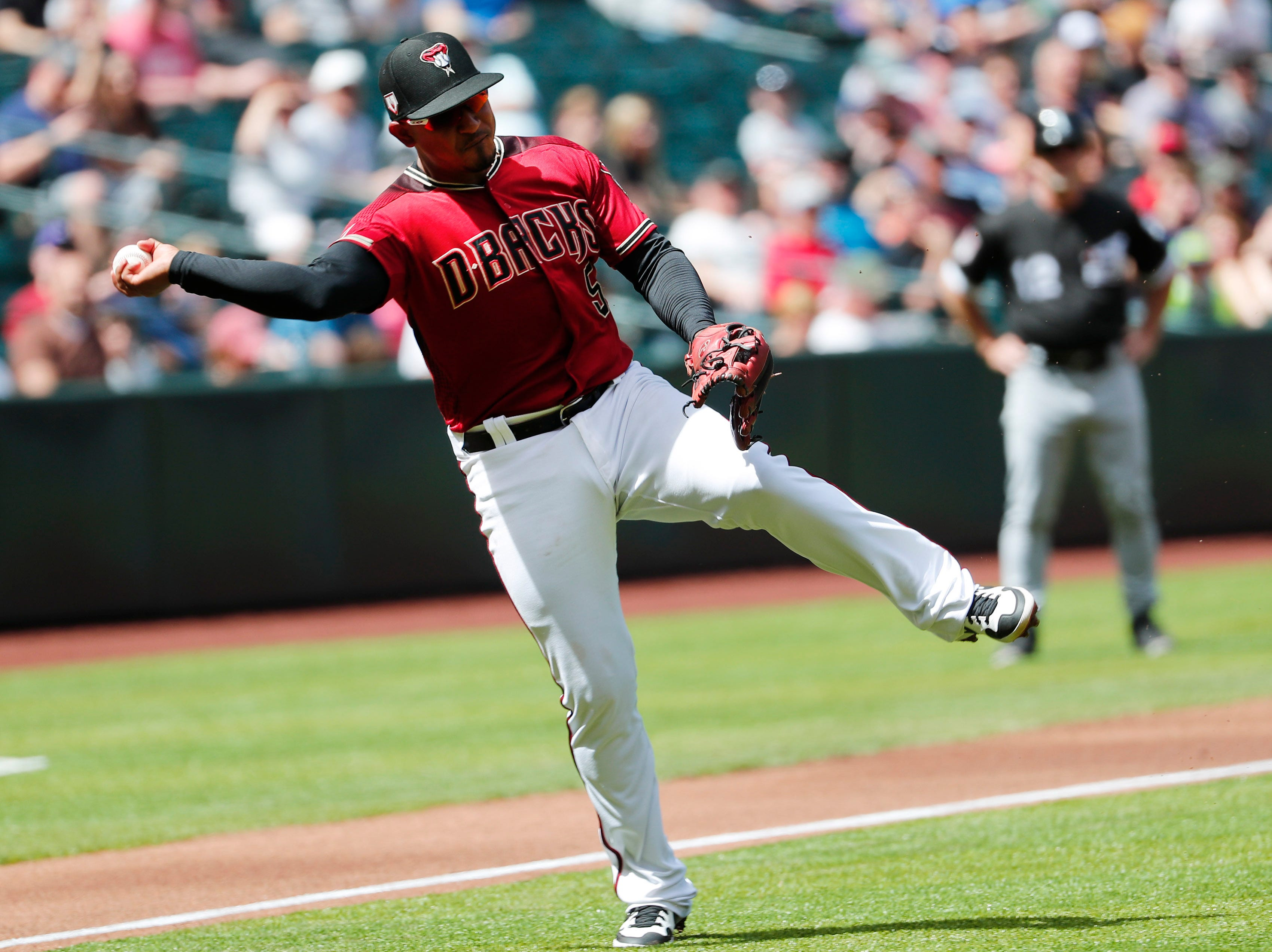 Arizona Diamondbacks third baseman Eduardo Escobar (5) throws out Chicago White Sox third baseman Yolmer Sanchez (5) on a bunt attempt during spring training action at Chase Field March 26, 2019.