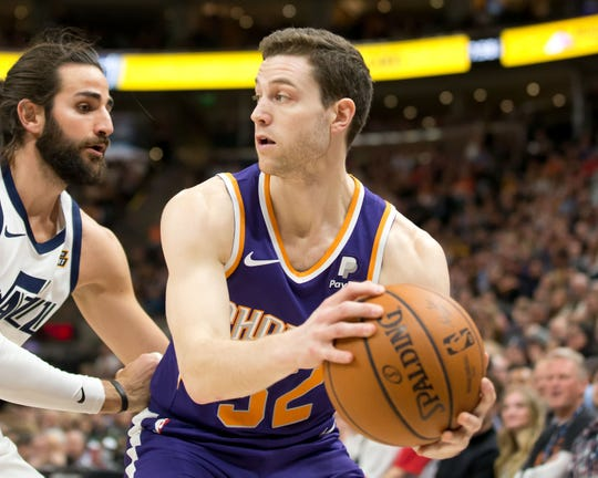 Mar 25, 2019: Utah Jazz guard Ricky Rubio (3) defends against Phoenix Suns guard Jimmer Fredette (32) during the first half at Vivint Smart Home Arena.