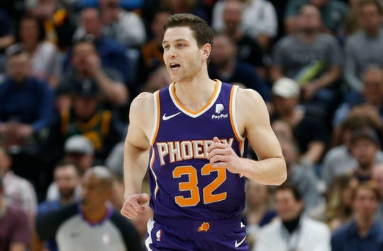 Phoenix Suns guard Jimmer Fredette (32) runs up court during the first half of an NBA basketball game against the Utah Jazz Monday, March 25, 2019, in Salt Lake City. (AP Photo/Rick Bowmer)