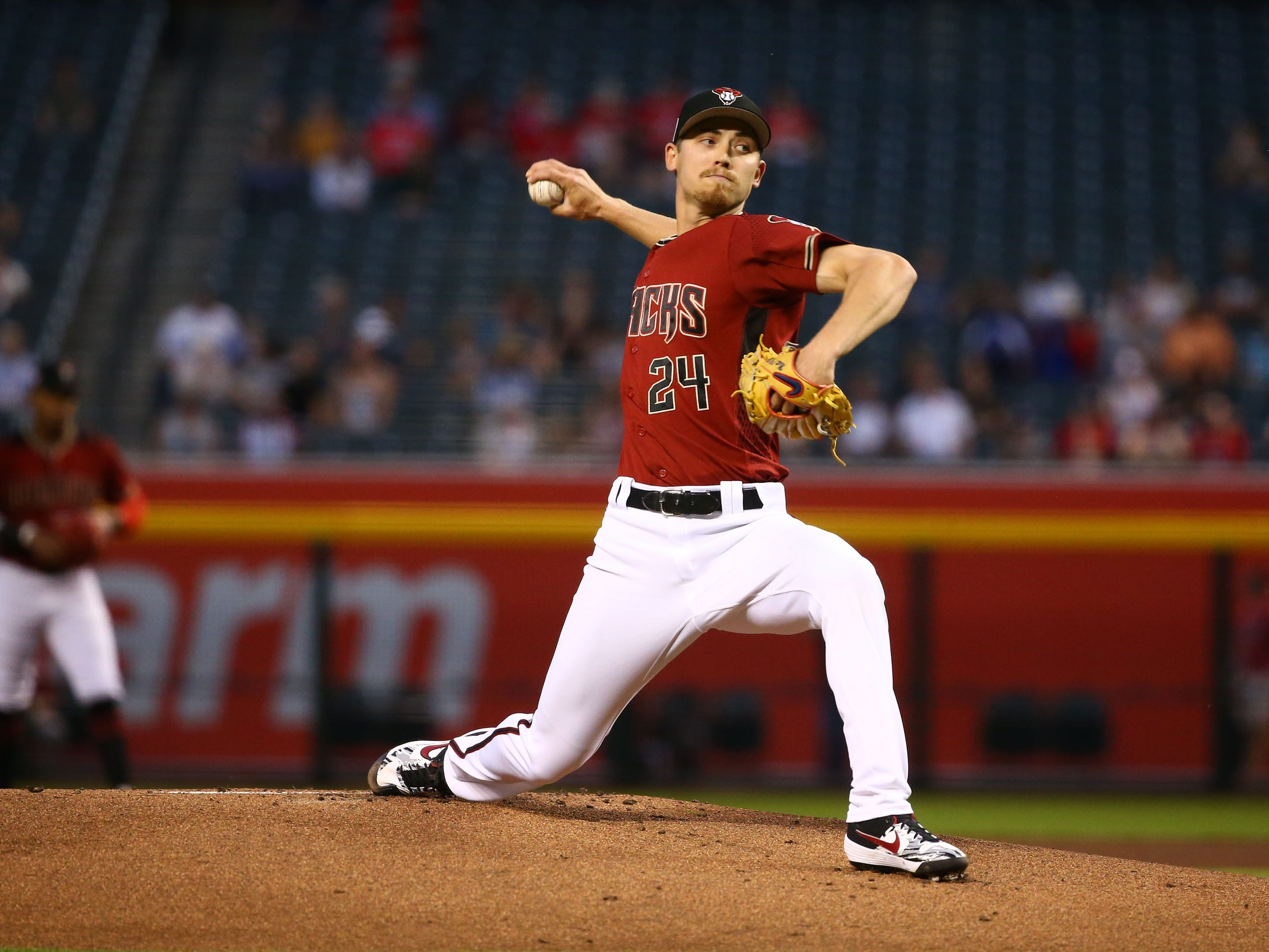 Arizona Diamondbacks pitcher Luke Weaver (24) throws to the Chicago White Sox in the first inning during a spring training game on Mar. 25, 2019 at Chase Field in Phoenix, Ariz.