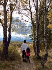 Bryan Wilson, 12, with sister Penelope, 4, at Grand Teton National Park.