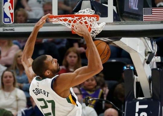 Utah Jazz center Rudy Gobert (27) dunks the ball against the Phoenix Suns during the first half of an NBA basketball game Monday, March 25, 2019, in Salt Lake City. (AP Photo/Rick Bowmer)
