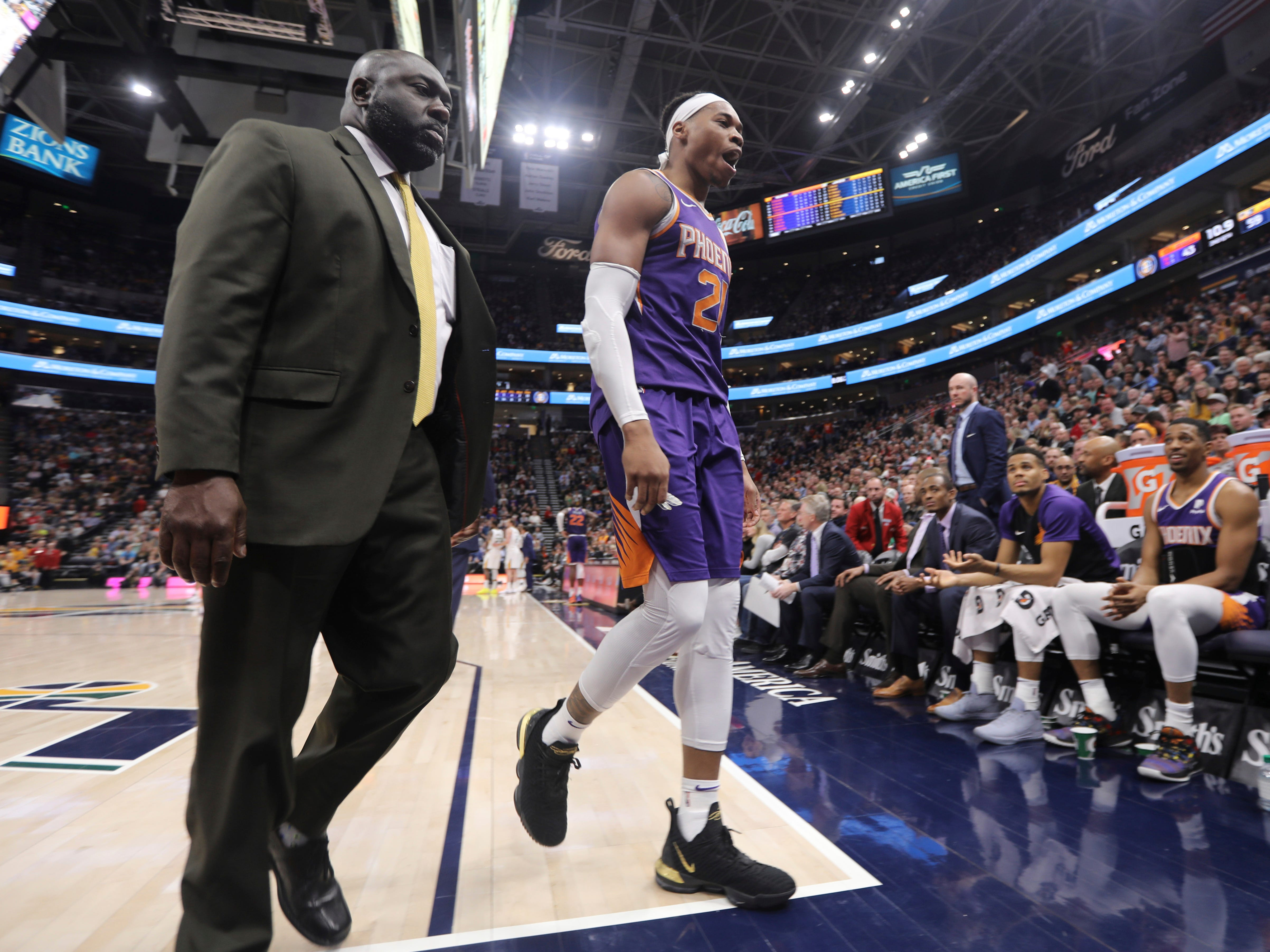 Phoenix Suns forward Richaun Holmes (21) leaves the court after being ejected during the first half of an NBA basketball game against the Utah Jazz, Monday, March 25, 2019, in Salt Lake City.