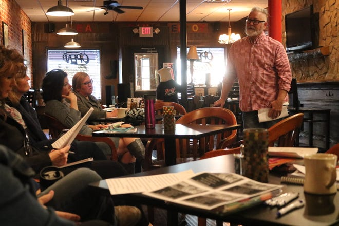 Keith Fleming, right, president of the Greater Port Clinton Area Arts Council, discusses plans for the monthly Art Walks to be held in 2019 from May through September.