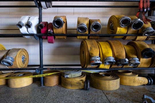 Hoses are stored on a rack inside Port Huron Fire Department's central station Tuesday, March 26, 2019.