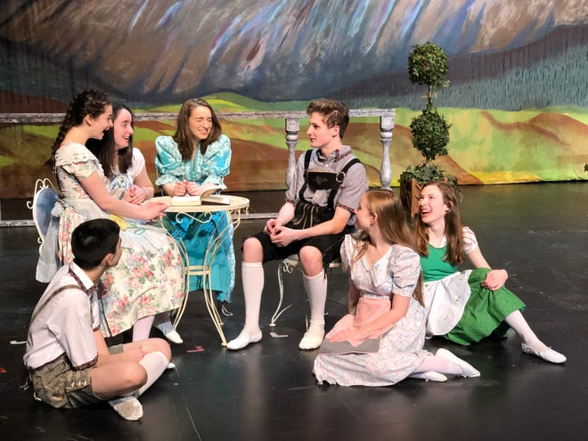 """The Von Trapp children talk about their governess who has just returned to them in the Roy C. Ketcham High School's Masque and Mime Society production of """"The Sound of Music."""" Picture, left to right, are students Tommy Galletta, Callie O'Shea, Avery Nurzia, Angel McLees, Glen Chitty, Alanna Nappi and Jasmin Gunn."""