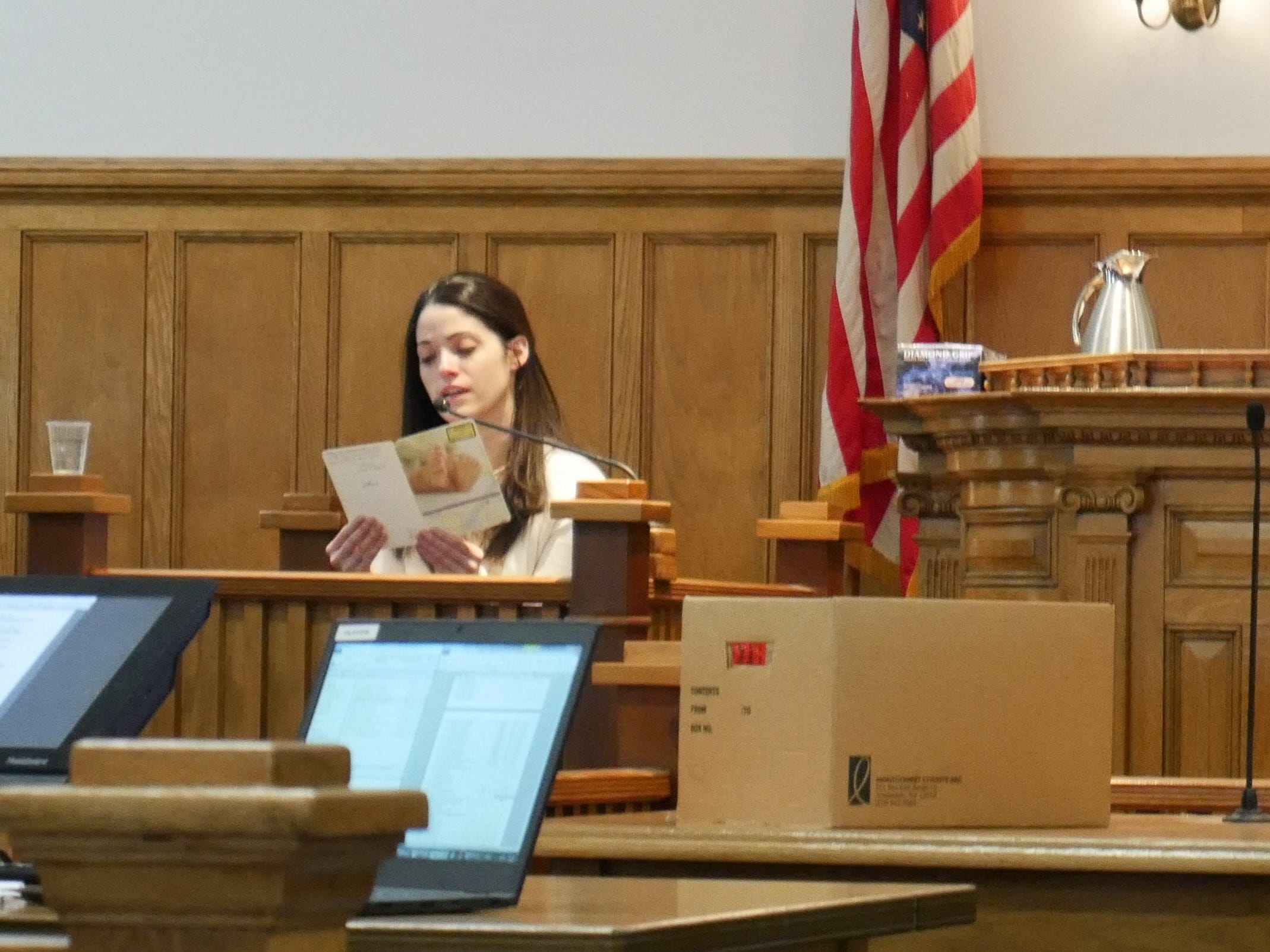 Nicole Addimando reads a card that she gave to Christopher Grover, in which she shared reasons she thought he would be a good dad, during her testimony in Dutchess County Court on March 26, 2019, at the request of prosecutors.