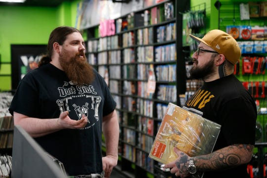 Darkside Records co-owner Justin Johnson talks with Mike Shishmanian about some upcoming vinyl releases at Darkside Records in the Town of Poughkeepsie on March 25, 2019.
