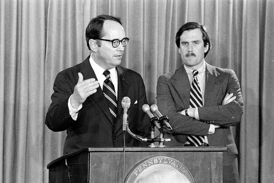 Pennsylvania Governor Dick Thornburgh, left, announces the closing of schools in the area around the Three Mile Island PWR, on March 30, 1979, in Harrisburg, Pa., after an accident at the nuclear power plant led to the release of radioactive gas from the reactor into the atmosphere. The governor advised the evacuation of small children and pregnant women. Standing at right is Lt. Gov. William Scranton. (AP Photo)