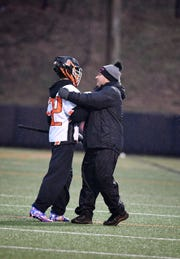 York Suburban head coach Frank Corto greets his son, Dominic, after he became York Suburban's all-time leading scorer on  Monday, March 24, 2019.