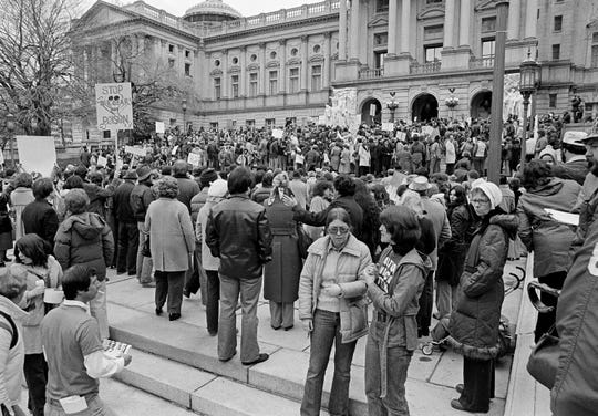 Anti-nuclear power plant demonstrators mass on the front steps of the State Capitol in Harrisburg, Penn., April 8, 1979, urging a shut-down of Three Mile Island nuclear power plant. The plant had an accident, causing radiation to leak into the atmosphere. (AP Photo/Paul Vathis)