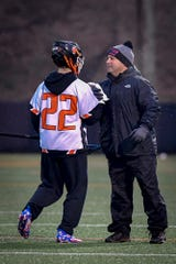 York Suburban head coach Frank Corto greets his son Dominic after he became the Trojans' all-time leading scorer last season. John A. Pavoncello photo