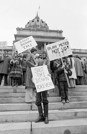 Two mothers along with their children carry signs in front of the State Capitol in Harrisburg, Penn., joining other anti-nuclear power plant demonstrators urging the shut-down of Three Mile Island (TMI) nuclear power plant near Harrisburg, April 8, 1979. The plant had an accident causing radiation to leak into the atmosphere. (AP Photo/Paul Vathis)