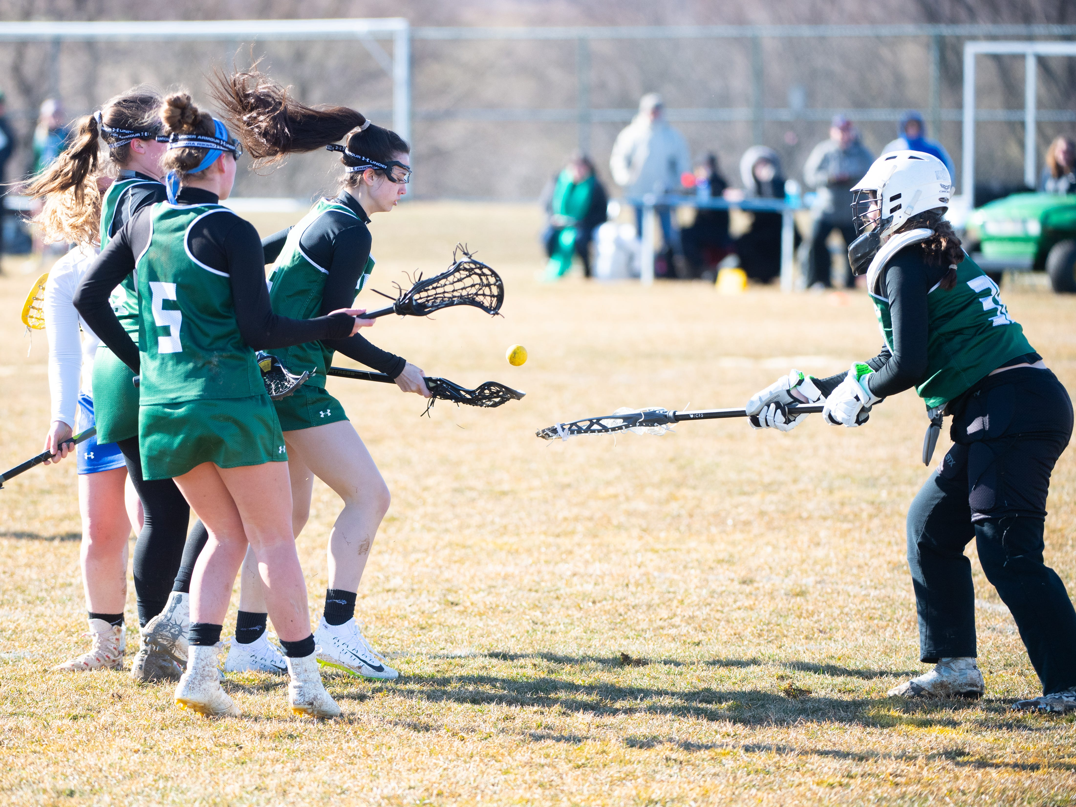 York Catholic looks to get the ball out of their zone the ball during the girls' lacrosse game between Kennard-Dale and York Catholic, March 26, 2019 at Kennard-Dale High School. The Fighting Irish defeated the Rams 10 to 9.