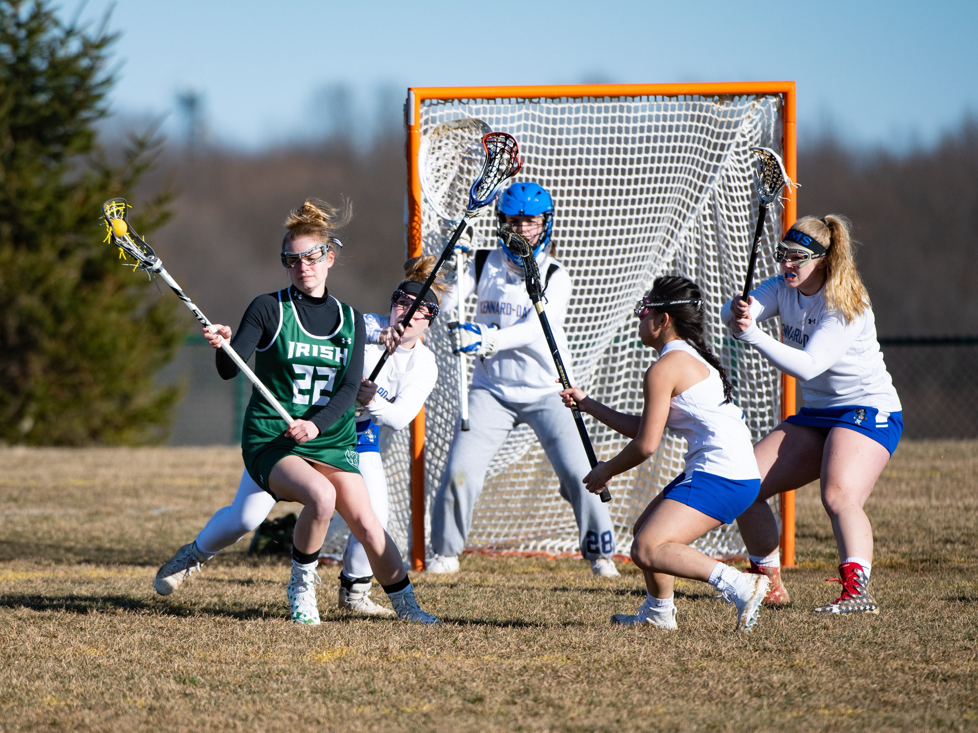 Natalie Neiman (22) spins off of the defense during the girls' lacrosse game between Kennard-Dale and York Catholic, March 26, 2019 at Kennard-Dale High School. The Fighting Irish defeated the Rams 10 to 9.