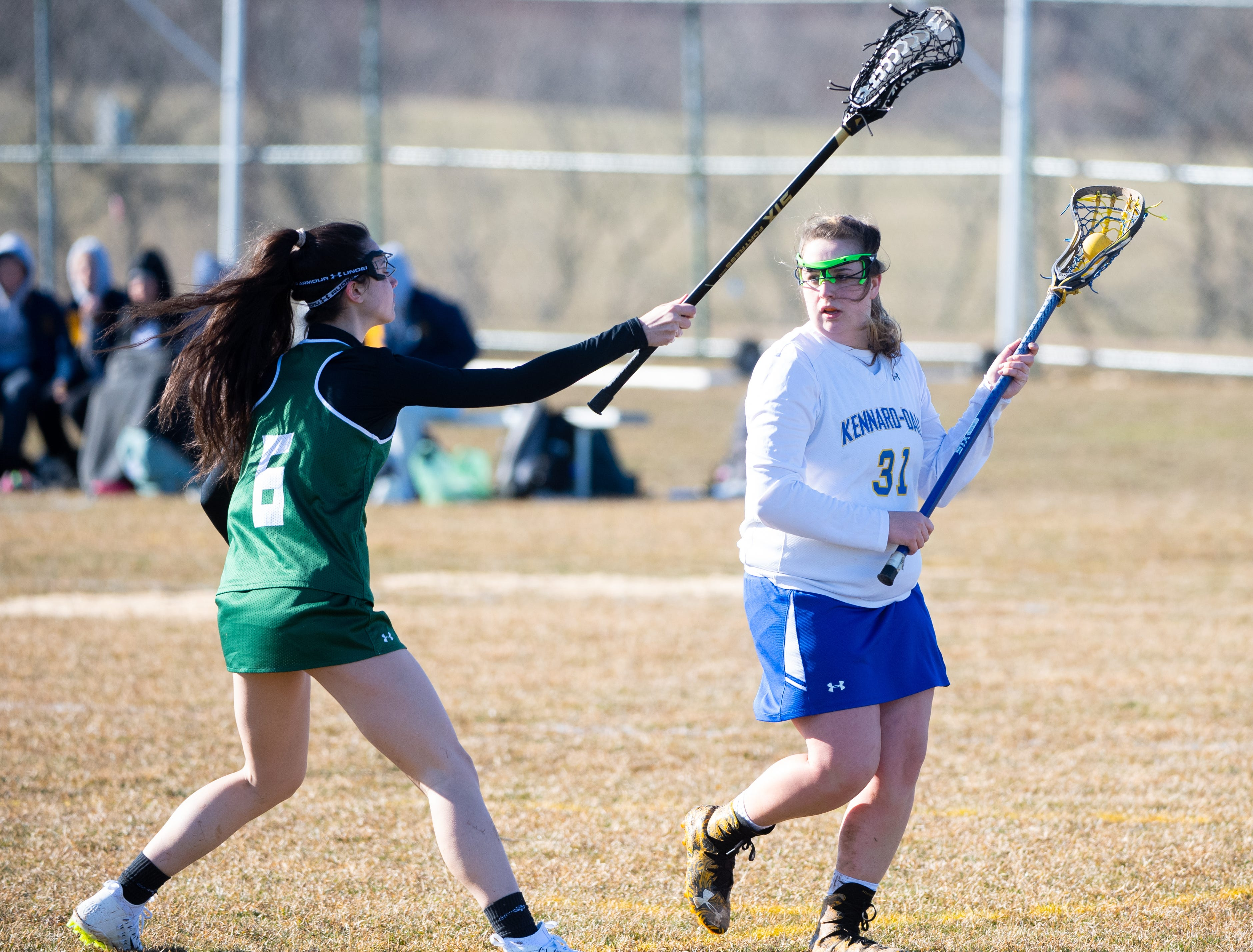 Autumn Kraemer (31) looks to pass during the girls' lacrosse game between Kennard-Dale and York Catholic, March 26, 2019 at Kennard-Dale High School. The Fighting Irish defeated the Rams 10 to 9.