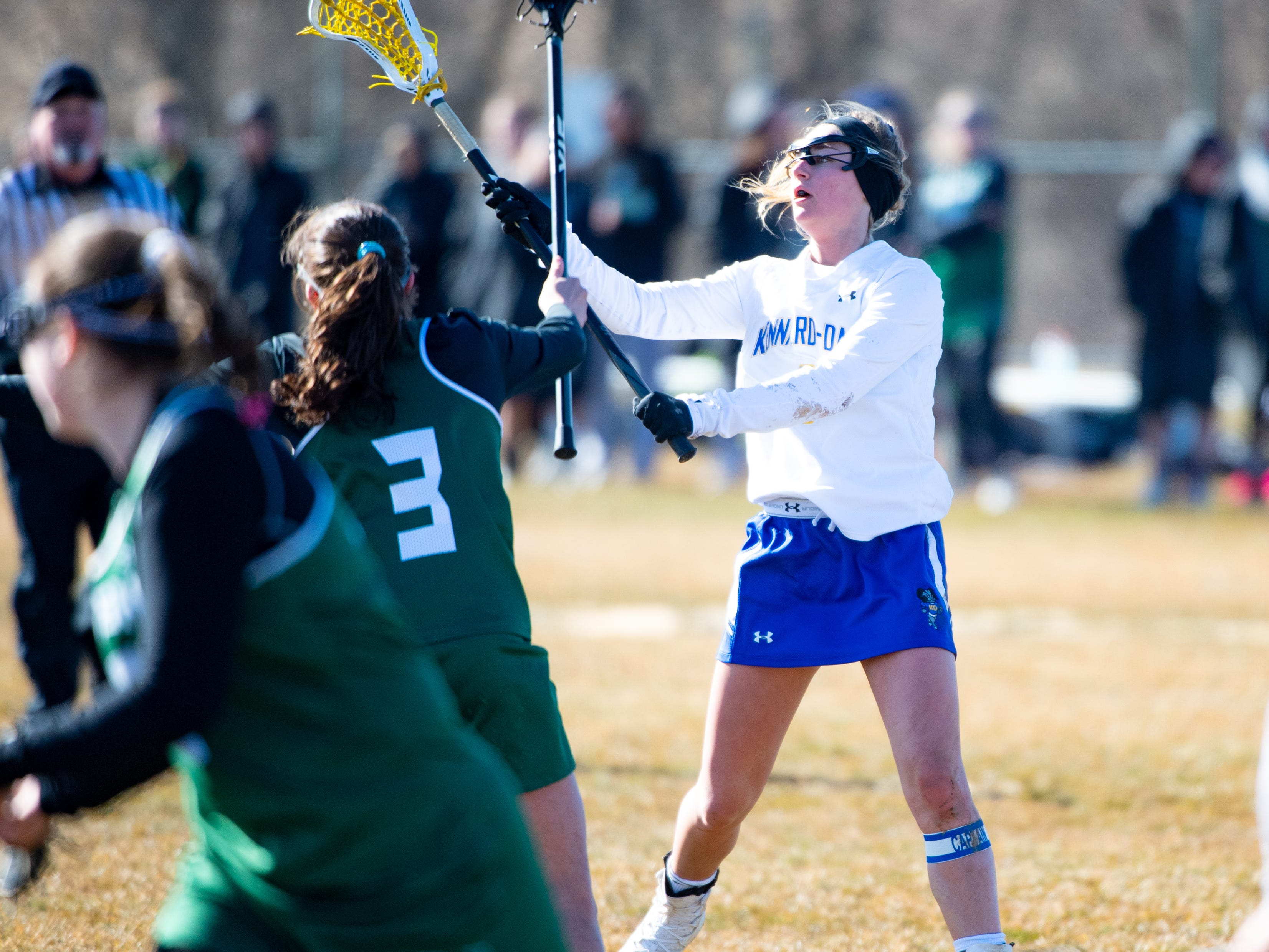 Megan Halczuk (9) throws the ball across field during the girls' lacrosse game between Kennard-Dale and York Catholic, March 26, 2019 at Kennard-Dale High School. The Fighting Irish defeated the Rams 10 to 9.