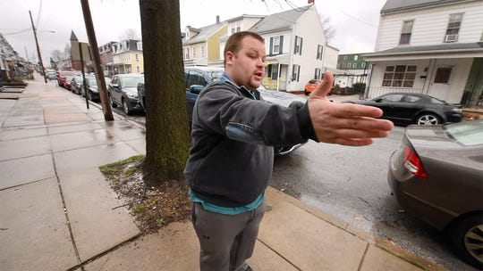 Christopher Wilhelm shows how the street fills up when people get off of work in the evening when he is getting home from work. Sometimes he has to walk a couple blocks after parking his car. Wilhelm, a volunteer firefighter in North York, is fighting for handicapped parking in front of his home. He lost his leg to cancer and walks with a prosthesis.